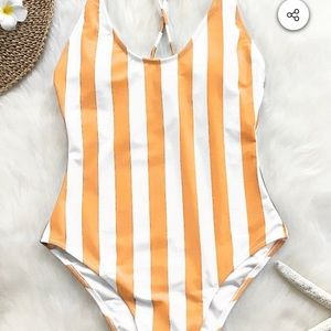 Unworn striped one-piece bathing suit